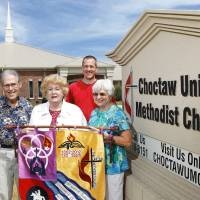 Photo - Afton Morton, Shirley McConnell, the Rev. Andy James and Sharon Brown stand in front of the Choctaw United Methodist Church, where members are celebrating the church's 120th anniversary. PHOTO BY Jim Beckel, THE OKLAHOMAN