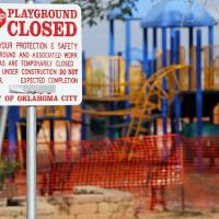 Photo - A sign announces the closure of the playground at Douglas Park, 500 NW 47 St., in Oklahoma City. Douglas Park is one of seven Oklahoma City parks where the playground was closed because of safety concerns.  Photo by Nate Billings,  The Oklahoman