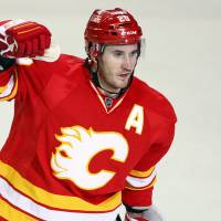 Photo - Calgary Flames' Curtis Glencross celebrates his goal against the Phoenix Coyotes during the third period of an NHL hockey game in Calgary, Alberta, Sunday, Feb. 24, 2013. Calgary won 5-4. (AP Photo/The Canadian Press, Jeff McIntosh)