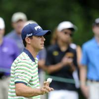 Photo - Billy Horschel acknowledges the gallery on the 15th green after putting during the first round of the AT&T National Golf tournament, Thursday, July 27, 2013, in Bethesda, Md. (AP Photo/Nick Wass)