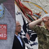 Photo - Britain's Prince Harry salutes during the opening ceremony for the 2013 Warrior Games, at the U.S. Olympic Training Center, in Colorado Springs, Colo., Saturday May 11, 2013. At left is Robin Lineberger, CEO of Deloitte, a sponsor of the Warrior Games. (AP Photo/Brennan Linsley)