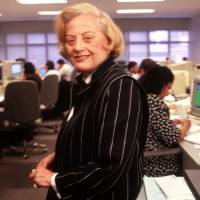 Photo - File- This May 9, 1995 file photo shows Muriel Siebert standing on the trading floor of her discount brokerage and underwriting firm in New York. Siebert, who started as a trainee on Wall Street and became the first woman to own a seat on the New York Stock Exchange, has died of complications of cancer at age 80.  Siebert died Saturday Aug. 24, 2013, at Memorial Sloan-Kettering Cancer Center in New York.  (AP Photo/Wyatt Counts, File)