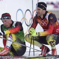 Photo - Germany's Hannes Dotzler and Tim Tscharnke, left, sit in the finish area after the men's cross-country team sprint competitions at the 2014 Winter Olympics, Wednesday, Feb. 19, 2014, in Krasnaya Polyana, Russia. (AP Photo/Matthias Schrader)