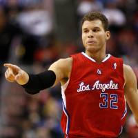 Photo - Los Angeles Clippers' Blake Griffin (32) points after he scored against the Philadelphia 76ers in the first half of an NBA basketball game, Monday, Feb. 11, 2013, in Philadelphia. (AP Photo/H. Rumph Jr)