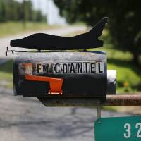 Photo - Ken McDaniel, a 78 year-old Air Force veteran, has a few hobbies including making metal replicas of military aircraft he, family or friends have flown. It started with a silhouette for his mailbox.   Jim Beckel - THE OKLAHOMAN