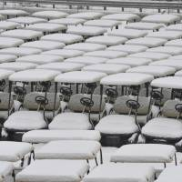 Photo - Golf carts, in a storage lot, are covered with snow in Holly, Mich., Thursday, Jan. 2, 2014.  (AP Photo/Detroit News,  Charles V. Tines) DETROIT FREE PRESS OUT; HUFFINGTON POST OUT, MADATORY CREDIT