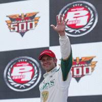 Photo - Ed Carpenter waves after winning the pole for the Indianapolis 500 IndyCar auto race at the Indianapolis Motor Speedway in Indianapolis, Sunday, May 18, 2014. (AP Photo/Tom Strattman)