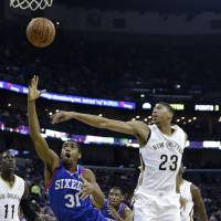 Photo - Philadelphia 76ers small forward Hollis Thompson (31) goes to the basket against New Orleans Pelicans power forward Anthony Davis (23) in the first half of an NBA basketball game in New Orleans, Saturday, Nov. 16, 2013. (AP Photo/Gerald Herbert)