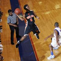 Photo - Stephen Clark (5) of Douglass saves the ball from going out-of-bounds during a boys high school basketball game between Douglass and Millwood at the Millwood Field House in Oklahoma City, Friday, Jan. 13, 2012. Photo by Nate Billings, The Oklahoman  NATE BILLINGS