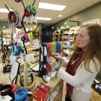 Photo - INTERNET SALES TAX: Morgan Harris, owner of the Green Bambino, at her store in Oklahoma City , Friday April 26, 2013. Photo By Steve Gooch, The Oklahoman
