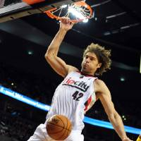 Photo - Portland Trail Blazers center Robin Lopez (42) dunks the ball during the second half of an NBA basketball game against the Golden State Warriors in Portland, Ore., Sunday, April 13, 2014. The Blazers won the game 119-117. (AP Photo/Steve Dykes)