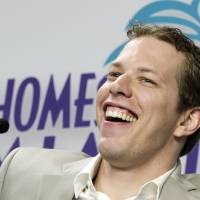 Photo -   NASCAR driver Brad Keselowski laughs at a reporters question during a news conference for the Sprint Cup Series auto race in Homestead, Fla., Thursday, Nov. 15, 2012. (AP Photo/Alan Diaz)