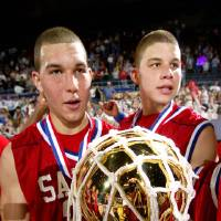 Photo - HIGH SCHOOL BASKETBALL STATE TOURNAMENT: Oklahoma Christian's Griffin Brothers (Tayor Griffin left and Blake right) are shown with the championship trophy after defeating Sequoyah-Tahlequah's in the OSSAA Class 3A State Championship finals at the State Fair Arena, in Oklahoma City, Saturday, March 12, 2005.   by Bill Waugh/The Oklahoman