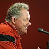 Photo - Louisville football coach Bobby Petrino answers questions about his NCAA college football team during a media day news conference in Louisville, Ky., Saturday, Aug. 9, 2014.  (AP Photo/Garry Jones)