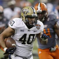 Photo - Pittsburgh running back James Conner (40) rushes during the second half of the Little Caesars Pizza Bowl NCAA college football game against Bowling Green, Thursday, Dec. 26, 2013, in Detroit. (AP Photo/Carlos Osorio)