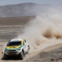 Photo - Guilherme Spinelli and co-pilot Youssef Haddad, both of Brazil, drive their Mitsubishi during the eight stage of the Dakar Rally between the cities of Salta, Argentina, and Calama, Chile, Monday, Jan. 13, 2014. (AP Photo/Victor R. Caivano)