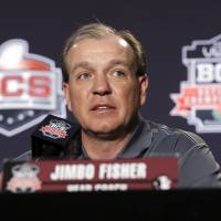 Photo - Florida State head coach Jimbo Fisher speaks during a news conference for the BCS National Championship NCAA college football game Tuesday, Jan. 7, 2014, in Newport Beach, Calif. Florida State beat Auburn 34-31 to win the championship the night before. (AP Photo/Morry Gash