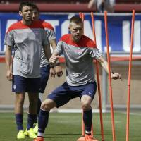 Photo - United States' Aron Johannsson performs drills during training in preparation for the World Cup soccer tournament, Thursday, May 22, 2014, in Stanford, Calif. (AP Photo/Ben Margot)