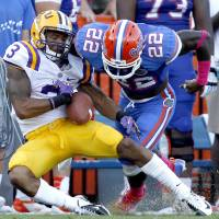 Photo -   Florida safety Matt Elam, right, forces LSU wide receiver Odell Beckham Jr. to fumble the ball after a long reception during the third quarter of an NCAA college football game at Ben Hill Griffin Stadium on Saturday, Oct. 6, 2012 in Gainesville, Fla. Florida recovered the fumble and defeated LSU 14-6. (AP Photo/Matt Stamey, The Gainesville Sun) MAGS OUT, INDEPENDENT ALLIGATOR OUT