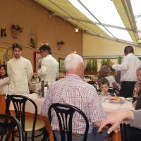 Photo -  The waiters at Terme di Diocleziano serve customers. (Photo by Tricia Tramel)