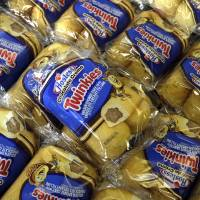 Photo -   Twinkies baked goods are displayed for sale at the Hostess Brands' bakery in Denver, Colo. on Friday, Nov. 16, 2012. Announcements that Hostess Brands will be going out of business prompted a buyers' run on the bakery. (AP Photo/Brennan Linsley)