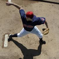 Photo - Cleveland Indians starting pitcher Justin Masterson warms up in the bullpen before an exhibition spring training baseball game against the Chicago White Sox, Friday, March 1, 2013, in Goodyear, Ariz. (AP Photo/Mark Duncan)