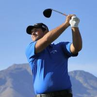 Photo - Patrick Reed hits from the 13th tee during the third round of the Humana Challenge PGA golf tournament on the Nicklaus Private course at PGA West, Saturday, Jan. 18, 2014, in La Quinta, Calif.  (AP Photo/Matt York)