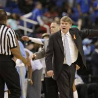 Photo - North Carolina associate head coach Andrew Calder, right, argues a call during the second half of an NCAA college basketball game against Maryland at the Atlantic Coast Conference tournament in Greensboro, N.C., Friday, March 7, 2014. North Carolina won 73-70. (AP Photo/Chuck Burton)