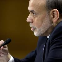 Photo - Federal Reserve Board Chairman Ben Bernanke testifies on Capitol Hill in Washington, Tuesday, Feb. 26, 2013, before the Senate Banking Committee hearing to deliver the central bank's Semiannual Monetary Policy Report to the Congress. (AP Photo/Carolyn Kaster)