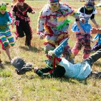 Photo - This February 2012 image provided by St. Landry Parish Tourist Commission shows young participants in a guinea hen chase in Eunice, La., a Mardi Gras season tradition in Louisiana's Cajun country. The region has its own family-oriented Mardi Gras customs rooted in rural traditions, very different from the Mardi Gras parties and parades of New Orleans. (AP Photo/St. Landry Parish Tourist Commission, David Simpson)