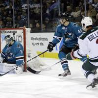 Photo - Minnesota Wild's Keith Ballard (2) scores past San Jose Sharks goalie Antti Niemi (31) of Finland, during the second period of an NHL hockey game on Saturday, Jan. 25, 2014, in San Jose, Calif. (AP Photo/Marcio Jose Sanchez)