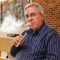 Photo - OSU music professor Todd Malicoate smokes an e-cigarette. The school is considering banning e-cigarettes.  Photo by Paul Hellstern, The Oklahoman