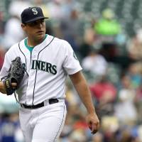 Photo -   Seattle Mariners starter Jason Vargas walks off the field after an inning in which he gave up a three-run home run against the Oakland Athletics in the fifth inning of a baseball game in Seattle, Sunday, Sept 9, 2012. (AP Photo/Stephen Brashear)