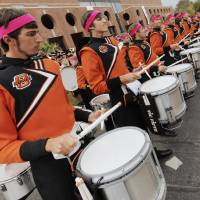 Photo - The drummers from the OSU Cowboy Marching Band play at the start of the Spirit Walk before the college football game between the Oklahoma State Cowboys (OSU) and the Nebraska Huskers (NU) at Boone Pickens Stadium in Stillwater, Okla., Saturday, Oct. 23, 2010. Photo by Nate Billings, The Oklahoman