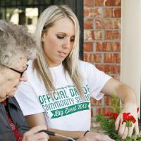 Photo - University of Oklahoma student Jodie Neal plants flowers with Frances Smith at the Daily Living Centers, 3000 N. Rockwell, in Bethany, Okla., Saturday, April 13, 2013. Volunteers from OU worked across the metro area as part of The Big Event. Photo by Nate Billings, The Oklahoman