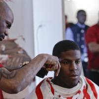 Photo - This May 6, 2014 photo shows NFL Draft prospect Kony Ealy, a defensive end from Missouri, getting a haircut during the 5th Annual NFL Pre-Draft Gifting & Style Suite at the Sean John showroom in New York. Ealy is among dozens of prospects on the  National Football League's annual draft, with 32 players per round and seven rounds, beginning Thursday night at Radio City. Ealy is projected to go late in the first round. (AP Photo/Frank Franklin II)