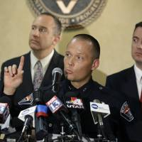 Photo - West Valley City Deputy Police Chief Mike Powell, center, makes remarks during a news conference, while West Valley City Mayor Mike Winder, right, and West Valley City Manager Wayne Pyle, left, look on Monday, May 20, 2013, in West Valley City, Utah. Citing a lack of leads, a police agency said Monday that it is closing the active investigation of the disappearance of Susan Powell, a Utah mother whose now-dead husband was a prime suspect. (AP Photo/Rick Bowmer)