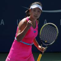 Photo - Shuai Peng, of China, reacts after a point against Agnieszka Radwanska, of Poland, of Australia, during the second round of the 2014 U.S. Open tennis tournament, Wednesday, Aug. 27, 2014, in New York. (AP Photo/Elise Amendola)