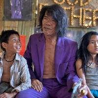 Photo - This undated publicity image released by the TriBeca Film Festival shows Sitthiphon Disamoe as Ahlo, left, Thep Phongam as Purple, and  Loungnam Kaosainam as Kia in a scene from