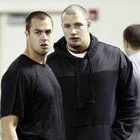 Photo - Quarterback Landry Jones, left, and offensive lineman Lane Johnson, right, talk before Oklahoma's NFL football pro day, Wednesday, March 13, 2013, in Norman, Okla. (AP Photo/Alonzo Adams) ORG XMIT: OKAA108