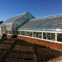 Photo - The rebuilt greenhouse at the Ed Lycan Conservatory at Will Rogers Gardens is opening to the public Wednesday, Nov. 20. Here is an outside view  STAFF WRITER - BY ROBERT MEDLEY