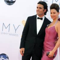 Photo - FILE - In this Sept. 23, 2012 file photo, actress Ashley Judd, right, and her husband, Dario Franchitti, arrives at the 64th Primetime Emmy Awards at the Nokia Theatre, in Los Angeles. Judd's spokeswoman confirmed a Tuesday, Jan. 29, 2013, report from People that the 44-year-old actress and 39-year-old Scottish race car driver are ending their marriage. (Photo by Matt Sayles/Invision/AP, File)