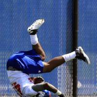 Photo -   Rookie tight end Larry Donnell tumbles as he makes a catch during drills at the New York Giants' NFL football rookie minicamp in East Rutherford, N.J., Friday, May 11, 2012. (AP Photo/Mel Evans)