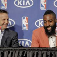 Photo - NBA BASKETBALL: Coach Scott Brooks and James Harden laugh as they speak during the presentation of the 2012 NBA Sixth Man of the Year Award to the Oklahoma City Thunder's James Harden on Thursday,  May 10, 2012, in Oklahoma City, Oklahoma. Photo by Chris Landsberger, The Oklahoman