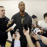 Photo - Brooklyn Nets center Jason Collins talks with reporters during  practice on the campus of UCLA in Los Angeles Tuesday, Feb. 25, 2014.  Collins became the first openly gay active athlete in North America's four major professional sports Sunday, Feb. 23, signing a 10-day contract with the Brooklyn Nets. (AP Photo/Reed Saxon)