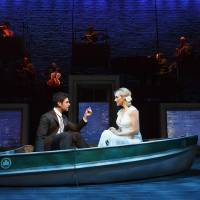 Photo - This theater image released by The Hartman group shows Adam Kantor, left, and Betsy Wolfe during a performance of