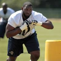 Photo -   St. Louis Rams defensive tackle Michael Brockers takes part in a drill during NFL football practice, Wednesday, May 16, 2012, at the team's training facility in St. Louis. (AP Photo/Jeff Roberson)