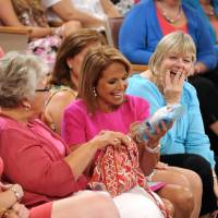 Photo - Katie Couric sits with audience members during a taping of her new talk show