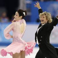 Photo - Meryl Davis and Charlie White of the United States compete in the ice dance short dance figure skating competition at the Iceberg Skating Palace during the 2014 Winter Olympics, Sunday, Feb. 16, 2014, in Sochi, Russia. (AP Photo/Darron Cummings)