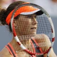 Photo -   Samantha Stosur, of Australia, returns a shot to Britain's Laura Robson in the third round of play at the 2012 US Open tennis tournament, Sunday, Sept. 2, 2012, in New York. (AP Photo/Kathy Willens)